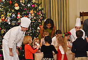 The First Lady of the United States Michelle Obama greets children of military families at the White House for Christmas fun and to show the White House Christmas decorations