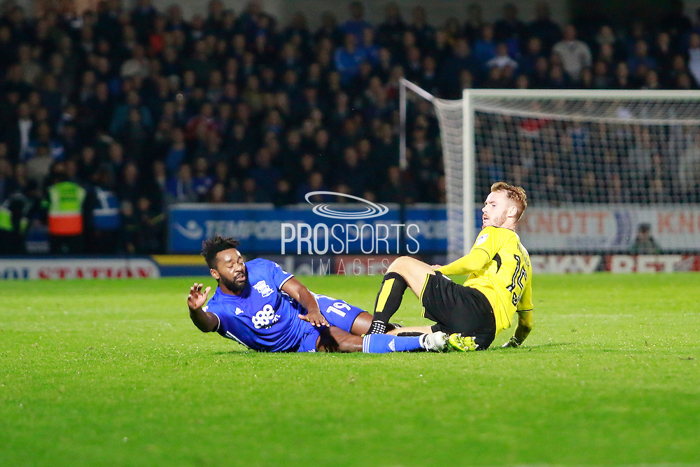 Burton's Tom Naylor (15) receives a yellow card for a tackle on Birmingham's Jacques Maghoma (19) during the EFL Sky Bet Championship match between Burton Albion and Birmingham City at the Pirelli Stadium, Burton upon Trent, England on 21 October 2016. Photo by Richard Holmes.