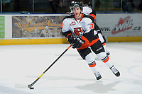 KELOWNA, CANADA, OCTOBER 11: Trevor Cox #36 of the Medicine Hat Tigers skates with the puck as the Medicine Hat Tigers visited the Kelowna Rockets on October 11, 2011 at Prospera Place in Kelowna, British Columbia, Canada (Photo by Marissa Baecker/shootthebreeze.ca) *** Local Caption ***Trevor Cox;