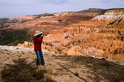 Woman making a photo at Cedar Breaks National Monument, Utah, UT, view, vista from Point Supreme, nature, landscape, erosion, arid, model released, Image ut307-17449, Photo copyright: Lee Foster, www.fostertravel.com, lee@fostertravel.com, 510-549-2202
