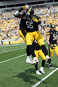 Pittsburgh Steelers outside linebacker Arthur Moats (55) leaps in the air and celebrates with Pittsburgh Steelers outside linebacker Tyler Matakevich (44) after Matakevich breaks up a fourth down pass attempt by the Minnesota Vikings on a fake punt in the third quarter during the 2017 NFL week 2 regular season football game against the against the Minnesota Vikings, Sunday, Sept. 17, 2017 in Pittsburgh. The Steelers won the game 26-9. (©Paul Anthony Spinelli)
