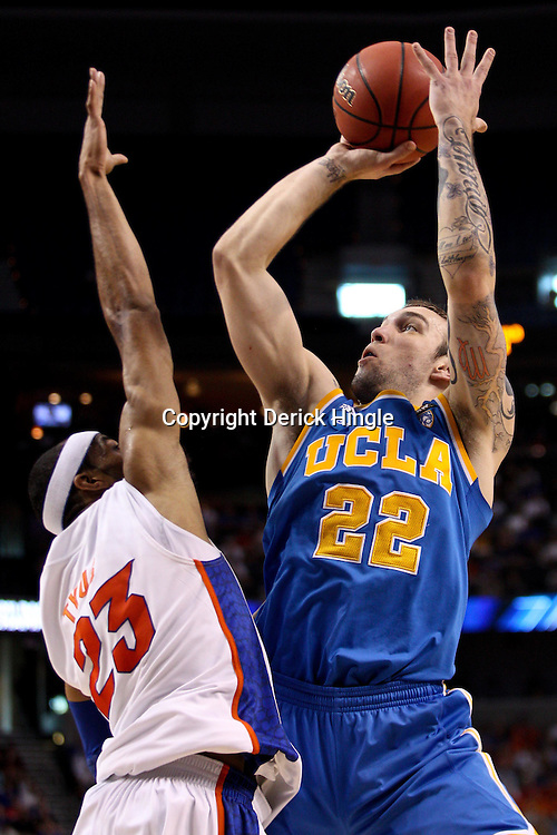 Mar 19, 2011; Tampa, FL, USA; UCLA Bruins forward Reeves Nelson (22) shoots over Florida Gators forward Alex Tyus (23) during second half of the third round of the 2011 NCAA men's basketball tournament at the St. Pete Times Forum. Florida defeated UCLA 73-65.  Mandatory Credit: Derick E. Hingle