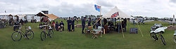 © Licensed to London News Pictures. 17/09/2011. GOODWOOD, UK. (PANORAMIC PICTURE TAKEN IN CAMERA) A live recreation of a WWII spitfire airfield. The Goodwood Revival at Goodwood in West Sussex today (17 September 2011). The revival is the world's largest historic motor race meeting, which relieves the 'glorious' days of the race circuit. Competitors and enthusiasts all dress in period fashion to enhance the experience. Photo credit : Stephen Simpson/LNP