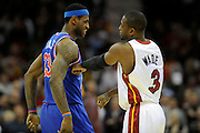 Feb 4, 2010; Cleveland, OH, USA; Cleveland Cavaliers forward LeBron James (23) and Miami Heat guard Dwyane Wade (3) joke around before the start of the game at Quicken Loans Arena. Mandatory Credit: Jason Miller-US PRESSWIRE