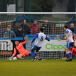 TELFORD COPYRIGHT MIKE SHERIDAN Matt Yates of Telford (on loan from Derby County) saves from Hamza Bencherif during the Buildbase FA Trophy 3Q fixture between Guiseley and AFC Telford United at Nethermoor Park on Saturday, November 23, 2019.<br /> <br /> Picture credit: Mike Sheridan/Ultrapress<br /> <br /> MS201920-031