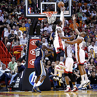 12 March 2011: Miami Heat shooting guard Dwyane Wade (3) blocks Memphis Grizzlies center Marc Gasol (33) during the Miami Heat 118-85 victory over the Memphis Grizzlies at the AmericanAirlines Arena, Miami, Florida, USA. **