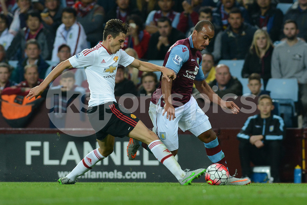 Manchester United's Matteo Darmian tackles Aston Villa's Gabby Agbonlahor during the Barclays Premier League match between Aston Villa and Manchester United at Villa Park, Birmingham, England on 14 August 2015. Photo by Garry Griffiths.
