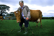 Babara Lake with her dairy cows at her farm in Cornwall, UK. For a story on Clotted Cream..Photo©Steve Forrest/Workers' Photos