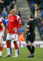 Photo: Steve Bond/Sportsbeat Images.<br />Leicester City v Charlton Athletic. Coca Cola Championship. 29/12/2007. Chris Iwelumo is booked by ref Scott Mathieson