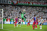 (C) Steaua's goalkeeper Ciprian Tatarusanu saves during the UEFA Champions League play-off second leg match between Legia Warsaw and FC Steaua Bucuresti at Pepsi Arena Stadium in Warsaw on August 27, 2013.<br /> <br /> Poland, Warsaw, August 27, 2013<br /> <br /> Picture also available in RAW (NEF) or TIFF format on special request.<br /> <br /> For editorial use only. Any commercial or promotional use requires permission.<br /> <br /> Photo by &copy; Adam Nurkiewicz / Mediasport