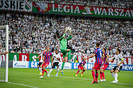 (C) Steaua's goalkeeper Ciprian Tatarusanu saves during the UEFA Champions League play-off second leg match between Legia Warsaw and FC Steaua Bucuresti at Pepsi Arena Stadium in Warsaw on August 27, 2013.<br /> <br /> Poland, Warsaw, August 27, 2013<br /> <br /> Picture also available in RAW (NEF) or TIFF format on special request.<br /> <br /> For editorial use only. Any commercial or promotional use requires permission.<br /> <br /> Photo by © Adam Nurkiewicz / Mediasport