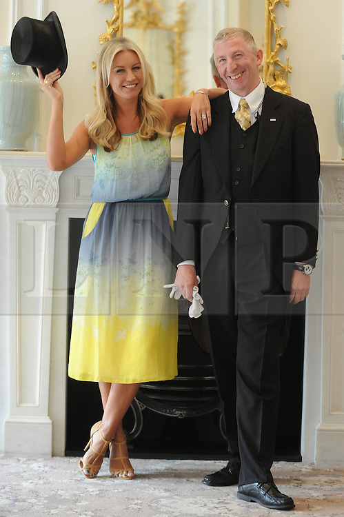 © Licensed to London News Pictures. 05/09/2012. London, UK. Denise Van Outen with a hotel footman at a photocall at The Savoy Hotel, London, calling on the public to make nominations for next year's Tesco Mum of the Year Awards. Photo credit : Thomas Campean/LNP