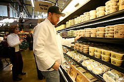 01 Feb 2006. Uptown, New Orleans, Louisiana.  Post Katrina. <br /> The Whole Foods supermarket reopens amidst great celebration 5 months after  the city was hit by Hurricane Katrina.  Customers pick out items from the shelves in the deli department.<br /> Photo; Charlie Varley/varleypix.com