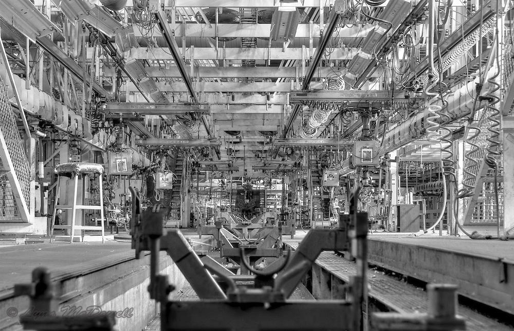 View of a final line chassis carrier and air hoses, the empty stool caught my attention, Chrysler main assembly plant, HDR image in Black and White