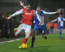 Bristol Rovers' David Clarkson chases down Morecambe's Mark Hughes - Photo mandatory by-line: Dougie Allward/JMP - Tel: Mobile: 07966 386802 14/12/2013 - SPORT - Football - Morecombe - Globe Arena - Morecombe v Bristol Rovers - Sky Bet League Two