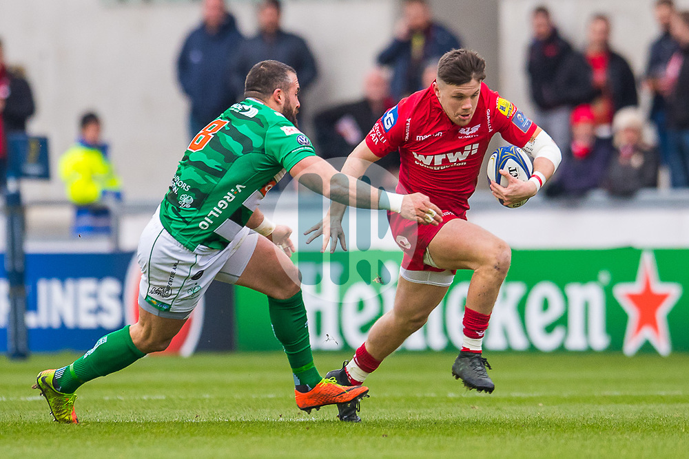 Scarlets' Steff Evans is tackled by Benetton Treviso's Robert Barbieri<br /> <br /> Photographer Simon King/Replay Images<br /> <br /> EPCR Champions Cup Round 3 - Scarlets v Benetton Rugby - Saturday 9th December 2017 - Parc y Scarlets - Llanelli<br /> <br /> World Copyright © 2017 Replay Images. All rights reserved. info@replayimages.co.uk - www.replayimages.co.uk