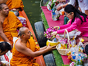 05 JANUARY 2019 - MINBURI, BANGKOK, THAILAND: SUDARAT KEYURAPHAN (right, pink blouse), the Pheu Thai Party candidate for Prime Minister of Thailand, presents alms to monks at the Kwan Riam Floating Market at Wat Bamphen Nuea in Minburi, east of downtown Bangkok. The Thai government has tentatively scheduled a general election for 24 February 2019. It will be Thailand's first election since a military coup overthrew the government of Yingluck Shinawatra in 2014. Yingluck was a the leader of the Pheu Thai Party before her ouster. Sudarat was a member of Thaksin Shinawatra's cabinet. Thaksin's government was also deposed by a coup in 2006.        PHOTO BY JACK KURTZ