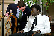 Karsiah Duncan, the son of Ebola patient Thomas Eric Duncan, speaks with Judge Clay Jenkins during a press conference at at Wilshire Baptist Church on October 7, 2014, in Dallas. (Cooper Neill for The New York Times)