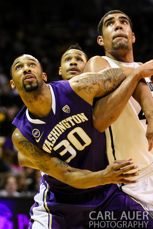 February 9th, 2014:  After leaving the game in the first half with a cut to his head, Washington Huskies junior forward Desmond Simmons (30) returned for a physical second half of the NCAA Basketball game between the Washington Huskies and the University of Colorado Buffaloes at the Coors Events Center in Boulder, Colorado