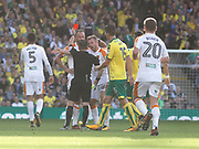 Hull City's David Meyler is shown the red card by referee Keith Stroud  during the EFL Sky Bet Championship match between Norwich City and Hull City at Carrow Road, Norwich, England on 14 October 2017. Photo by John Marsh.
