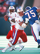 Houston Oilers offensive lineman Bruce Matthews (74) blocks Minnesota Vikings defensive tackle Keith Millard (75) during the 1990 NFL Pro Bowl between the National Football Conference and the American Football Conference on Feb. 4, 1990 in Honolulu. The NFC won the game 27-21. (©Paul Anthony Spinelli)