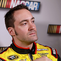 Driver Paul Menard speaks with the media during the NASCAR Media Day event at Daytona International Speedway on Thursday, February 14, 2013 in Daytona Beach, Florida.  (AP Photo/Alex Menendez)