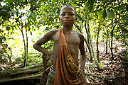 Firimin Kouassi, 13, on his uncle's cocoa plantation near the town of Moussadougou, Bas-Sassandra region, Cote d'Ivoire on Monday March 5, 2012. Firimin decided to abandon school.