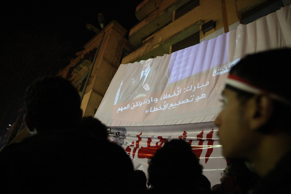 A projection of the Mubarak speech at Tahrir Square. Pro-democracy protesters watch the third speech of Mubarak since protests began calling for his ouster.