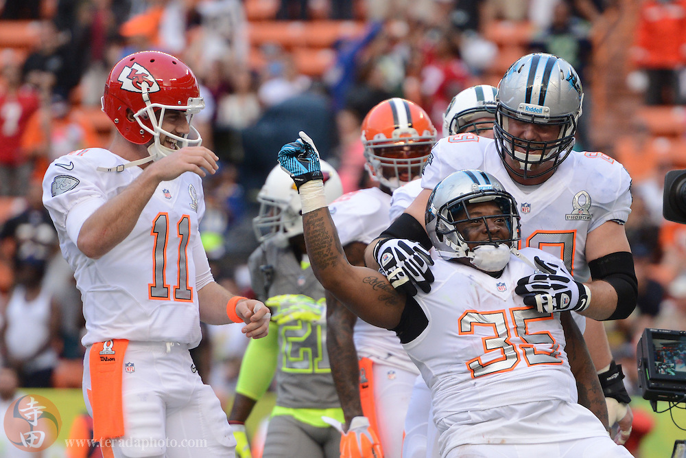 January 26, 2014; Honolulu, HI, USA; Team Rice fullback Mike Tolbert of the Carolina Panthers (35) celebrates after scoring the game-winning two-point conversion during the fourth quarter of the 2014 Pro Bowl against Team Sanders at Aloha Stadium. Team Rice defeated Team Sanders 22-21.