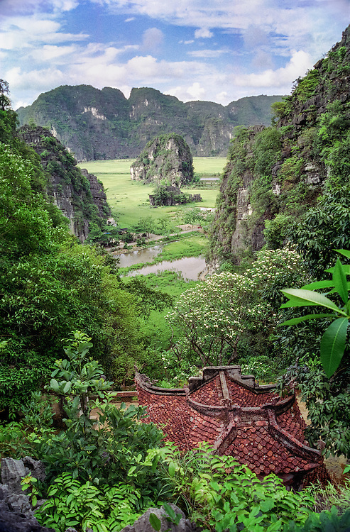 The view from above a temple in Tam Coc, overlooking rice fields and limestone mountains. Near Nimh Binh, Vietnam, 2003.
