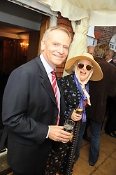 LORD ARCHER and author MARY KENNY at the Spectator Summer Party held at 22 Old Queen Street, London SW1 on 3rd July 2008.<br />