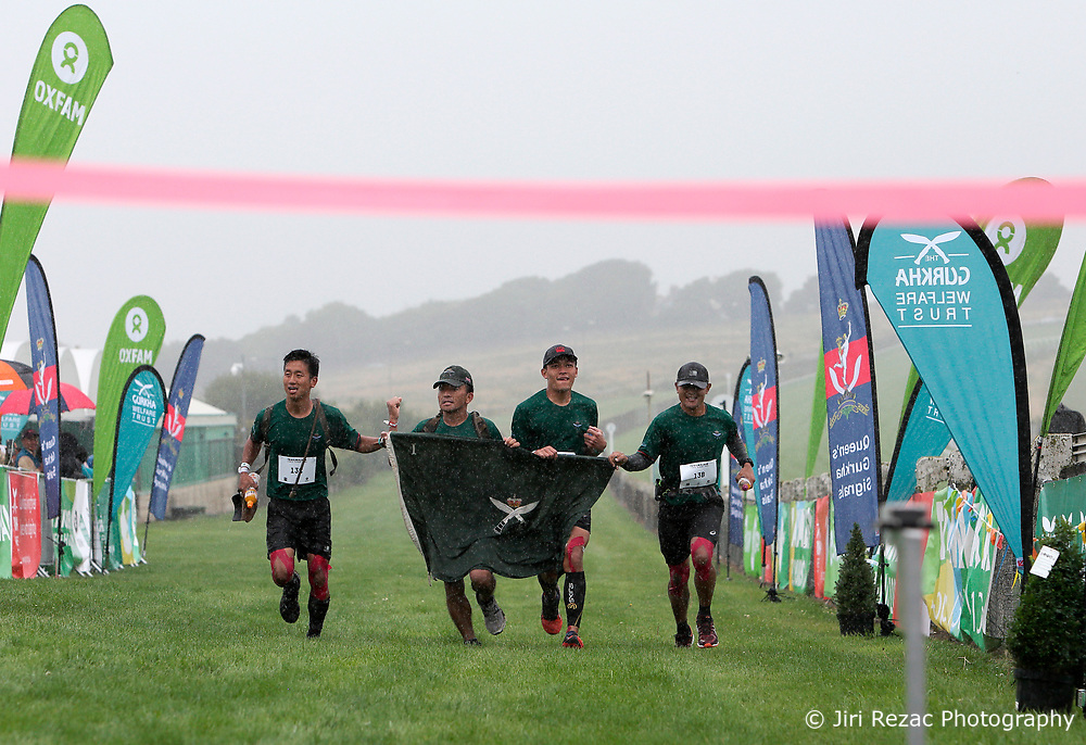UK ENGLAND 29JUL17 - Team 1RGR arrive as winners at the finish line on Brighton Racecourse after the Trailwalker 2017 challenge across the South Downs, England. They completed the 100Km race in 10 hours and 51 minutes.<br /> <br /> jre/Photo by Jiri Rezac<br /> <br /> © Jiri Rezac 2017