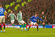 Mikey Johnston of Celtic FC & Ryan Jack of Rangers FC challenge for a 50/50 ball during the Betfred Scottish League Cup Final match between Rangers and Celtic at Hampden Park, Glasgow, United Kingdom on 8 December 2019.