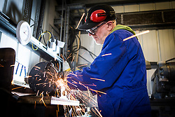 """© Licensed to London News Pictures. 04/05/2016. Birkenhead UK. Picture shows volunteer John Hake grinding metal work for the Daniel Adamson during restoration work at the Canada Dock volunteer workshop. The Daniel Adamson steam boat has been bought back to operational service after a £5M restoration. The coal fired steam tug is the last surviving steam powered tug built on the Mersey and is believed to be the oldest operational Mersey built ship in the world. The """"Danny"""" (originally named the Ralph Brocklebank) was built at Camel Laird ship yard in Birkenhead & launched in 1903. She worked the canal's & carried passengers across the Mersey & during WW1 had a stint working for the Royal Navy in Liverpool. The """"Danny"""" was refitted in the 30's in an art deco style. Withdrawn from service in 1984 by 2014 she was due for scrapping until Mersey tug skipper Dan Cross bought her for £1 and the campaign to save her was underway. Photo credit: Andrew McCaren/LNP ** More information available here http://tinyurl.com/jsucxaq **"""