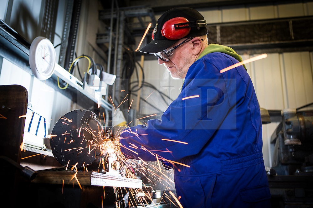 "© Licensed to London News Pictures. 04/05/2016. Birkenhead UK. Picture shows volunteer John Hake grinding metal work for the Daniel Adamson during restoration work at the Canada Dock volunteer workshop. The Daniel Adamson steam boat has been bought back to operational service after a £5M restoration. The coal fired steam tug is the last surviving steam powered tug built on the Mersey and is believed to be the oldest operational Mersey built ship in the world. The ""Danny"" (originally named the Ralph Brocklebank) was built at Camel Laird ship yard in Birkenhead & launched in 1903. She worked the canal's & carried passengers across the Mersey & during WW1 had a stint working for the Royal Navy in Liverpool. The ""Danny"" was refitted in the 30's in an art deco style. Withdrawn from service in 1984 by 2014 she was due for scrapping until Mersey tug skipper Dan Cross bought her for £1 and the campaign to save her was underway. Photo credit: Andrew McCaren/LNP ** More information available here http://tinyurl.com/jsucxaq **"