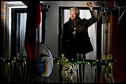 Julian Assange WikiLeaks founder addresses crowd from the Ecuadorian Embassy to mark six months since he arrived at the Embassy seeking political asylum. Assange took refuge at the Embassy on June 20 to avoid extradition to Sweden to face questioning for alleged sexual assault 2011, Thursday December 20, 2012. Photo by Andrew Parsons / i-Images