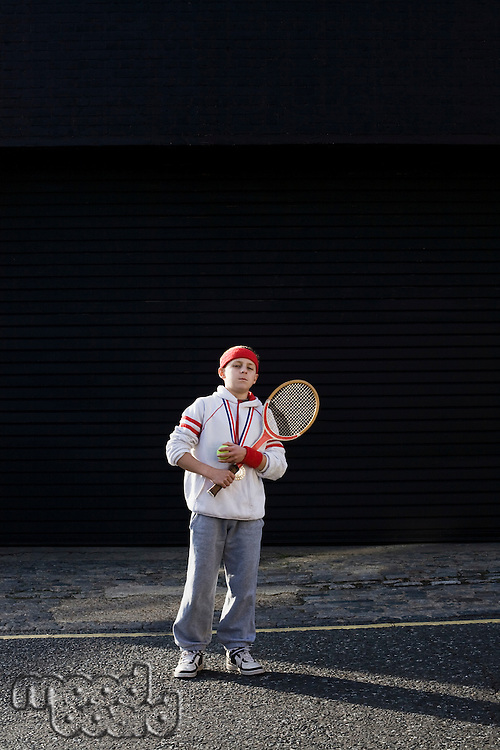 Boy holding tennis racket