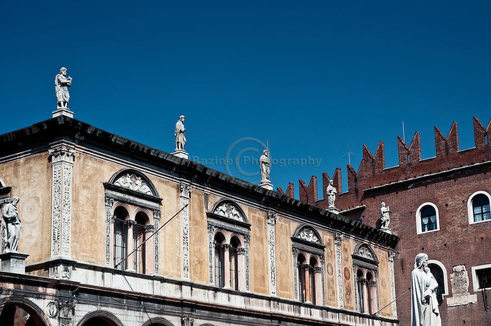 Statue of Dante positioned in front of Loggia del Consiglio in Piazza dei Signori, Verona Italy.