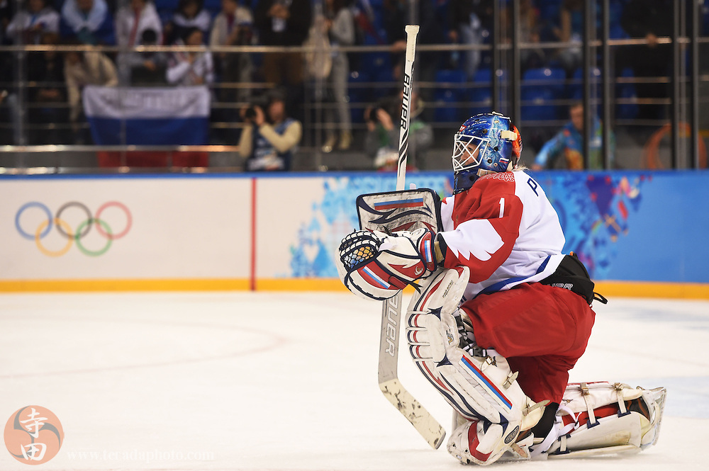Feb 15, 2014; Sochi, RUSSIA; Russia goalkeeper Anna Prugova (1) reacts after losing to Switzerland in a women's quarterfinals ice hockey game during the Sochi 2014 Olympic Winter Games at Shayba Arena.