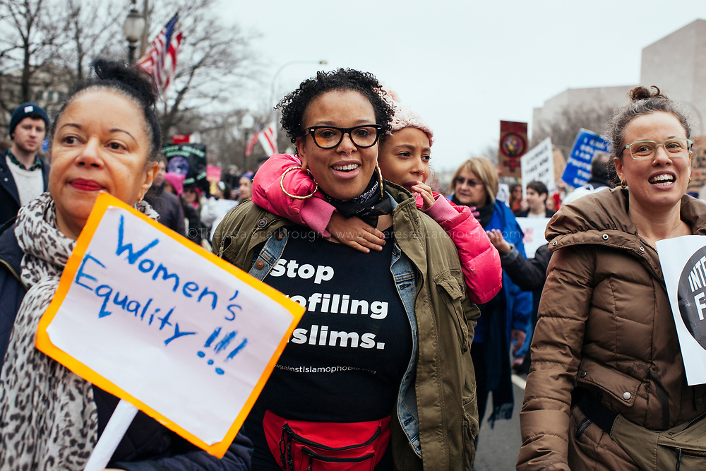 Shana and Lola (6 years old) Gittens march in the Women's March on Washington D.C., January 21, 2017