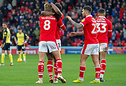 Barnsley midfielder Cameron McGeehan (8) Celebrates with Barnsley midfielder Dylan Mottley-Henry (17) as he sxores a goal 2-0  during the EFL Sky Bet League 1 match between Barnsley and Scunthorpe United at Oakwell, Barnsley, England on 2 February 2019.