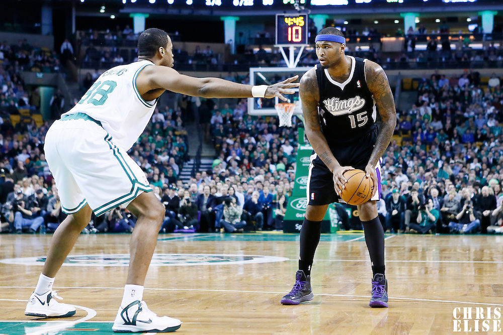 30 January 2013: Sacramento Kings center DeMarcus Cousins (15) looks to pass the ball over Boston Celtics center Jason Collins (98) during the Boston Celtics 99-81 victory over the Sacramento Kings at the TD Garden, Boston, Massachusetts, USA.