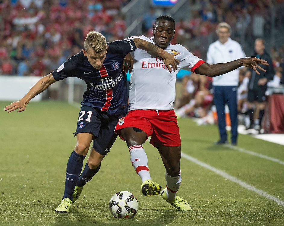 Paris St. Germain's Lucas Digne (left) and SL Benfica's Jean Christopher Bahebeck in the International Champions Cup in Toronto.