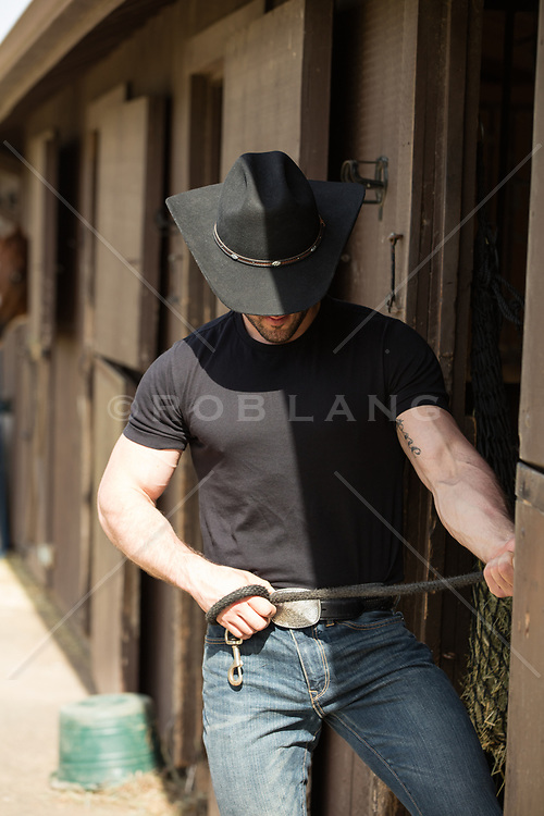 cowboy working around horse stables