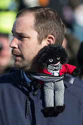 © Licensed to London News Pictures . 22/10/2016 . Margate , UK . A White Lives Protester with a Golliwog . A White Lives Matter protest and march , opposed by antifascists , is held in Margate , Kent . Photo credit : Joel Goodman/LNP