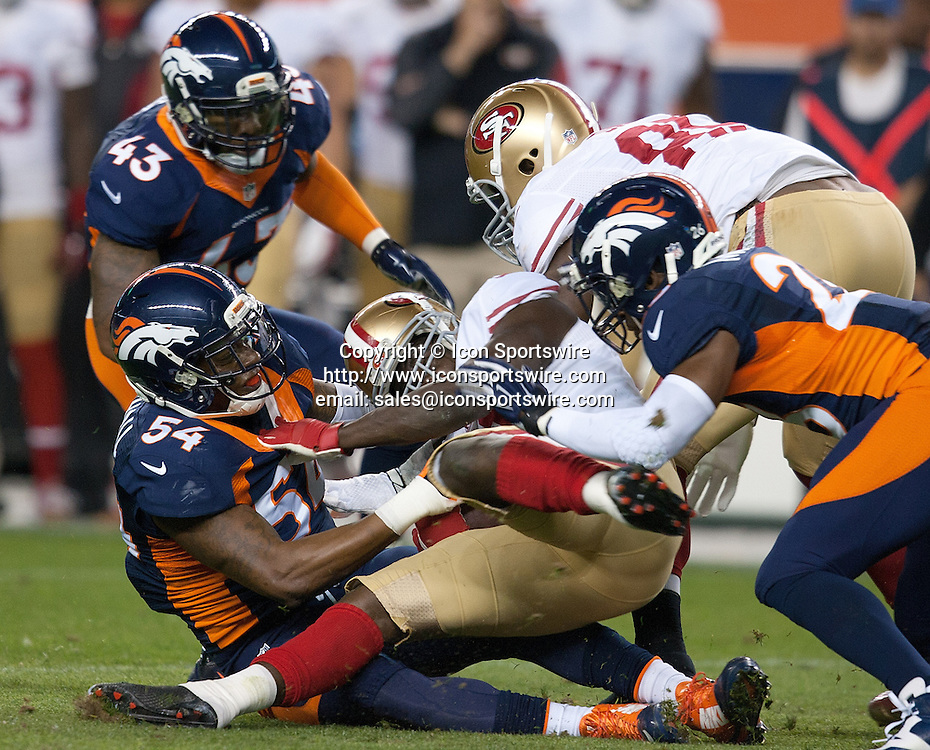Oct. 19, 2014 - Denver, Colorado, U.S - Broncos LB NATE IRVING, left, tackles 49ers RB FRANK GORE, center, during the 1st. half at Sports Authority Field at Mile High Sunday Evening. The Broncos beat the 49ers 42-17