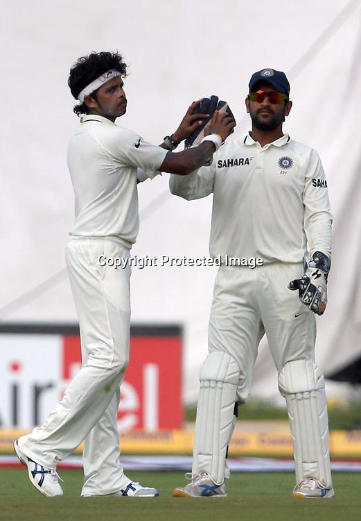 Indian bowler S. Sreesanth celebrates with MS Dhoni New Zealand batsman Tim Southee wicket during the Indian vs New Zealand 2nd test match day-5 Played at Rajiv Gandhi International Stadium, Uppal, Hyderabad 16 November 2010 (5-day match)