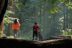 Mother and child walking in Sulham Woods; Reading; Berkshire; an area managed by the Forestry Commission, This area is mixed deciduous and conifer,