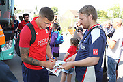 Swindon playrs sign autographs  before the EFL Sky Bet League 2 match between Cheltenham Town and Swindon Town at Jonny Rocks Stadium, Cheltenham, England on 24 August 2019.