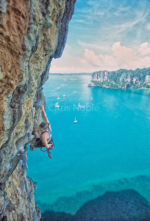 "American professional climber Beth Rodden climbing the classic ""Lord of the Thais,"" rated 7a, the ""Thaiwand Wall,"" Railei Beach, Southern Thailand 2001"